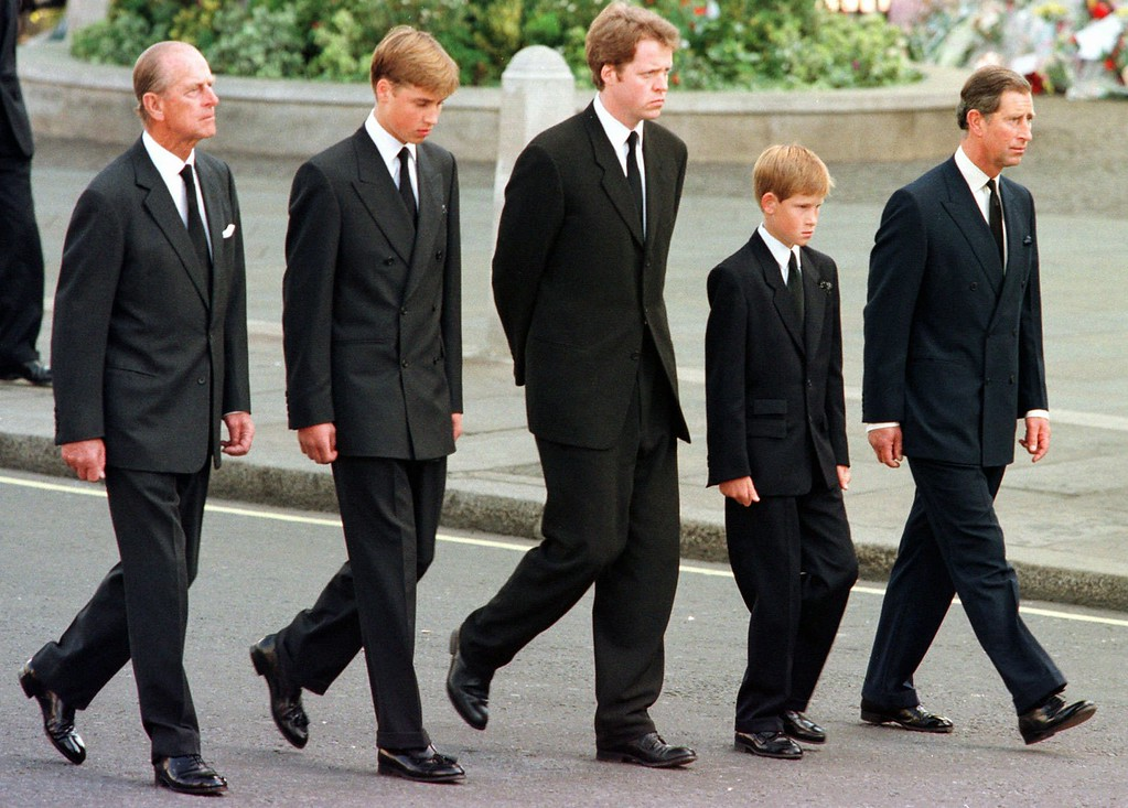 . The Duke of Edinburgh, Prince William, Earl Spencer, Prince Harry and Prince Charles walk outside Westminster Abbey during the funeral procession for Diana, Princess of Wales Saturday, Sept. 6, 1997. Diana, Princess of Wales, was killed in a car crash in Paris  on August 31, 1997. (AP Photo/Jeff J. Mitchell, Pool)