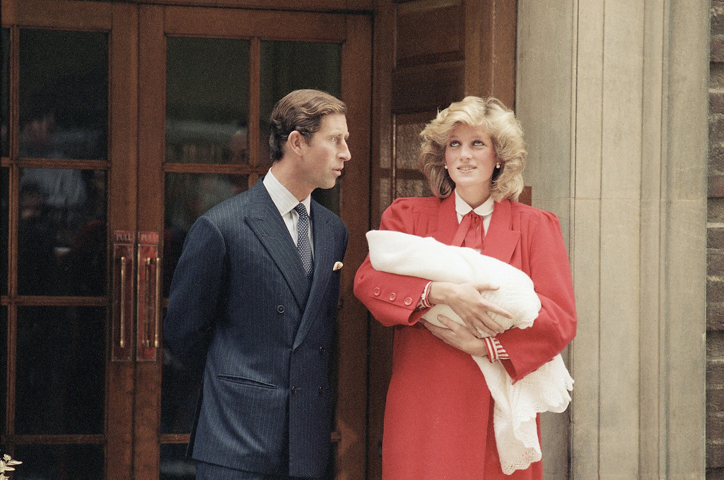 . The Prince and Princess of Wales, Prince Charles and Princess Diana leave St. Mary\'s Hospital in Paddington, London with their new baby son on Sept. 16, 1984.    Princess Diana carries new baby,  Prince Harry who was born on Sept. 15.    (AP Photo)