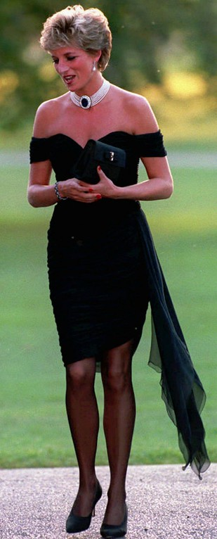 . FILE - Diana, Princess of Wales wearing a black pleated chiffon dress, with floating side panel, by Christina Stamboulian, during a party given at the Serpentine Gallery in London in this 1996 file photo. Princess Diana died in a car crash in Paris early Sunday August 31, 1997, along with her friend Dodi Fayed and the driver of the car. (AP Photo/Files)