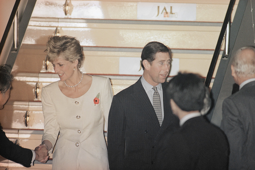 . Prince Charles and Princess Diana of Wales are greeted by well-wishers under the plane upon their arrival at Tokyo�s Haneda Airport, Nov. 10, 1990.  (AP Photo/Itsuo Inouye)