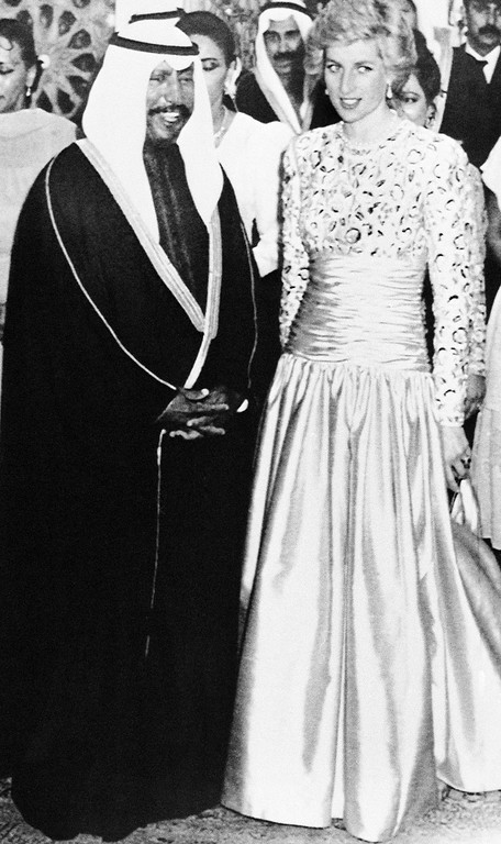. The Princess of Wales is escorted by the Crown Prince of Kuwait, Sheikh Saad Al-Abdulla, to a royal banquet given in honor of the princess and her husband, the Prince of Wales in Kuwait, United Arab Emirates on March 13, 1989. The British Royal couple are on a five day visit to the Gulf States. (AP Photo/Press Association)