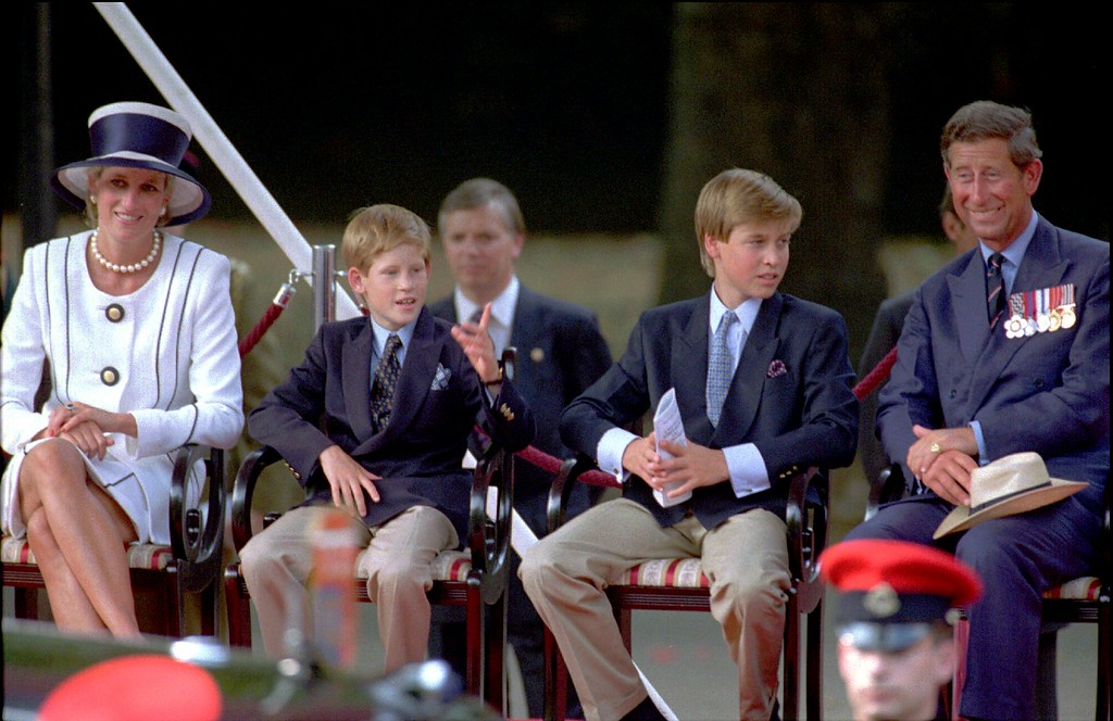 . Princess Diana, left, her sons Prince Harry and Prince William, and Prince Charles watch a veteran\'s parade during the 50th anniversary of VJ Day commemorations in London, Saturday Aug. 19, 1995.  (AP Photo/Alastair Grant)
