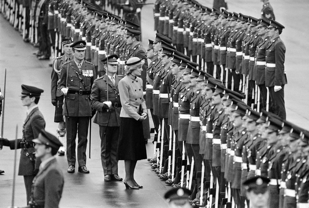 . HRH Princess Diana, Colonel-in-Chief of the Royal Hampshire Regiment, talks to soldiers lined-up for welcoming parade at Wavell Barracks in West Berlin on Friday, Oct. 18, 1985.  (AP Photo)