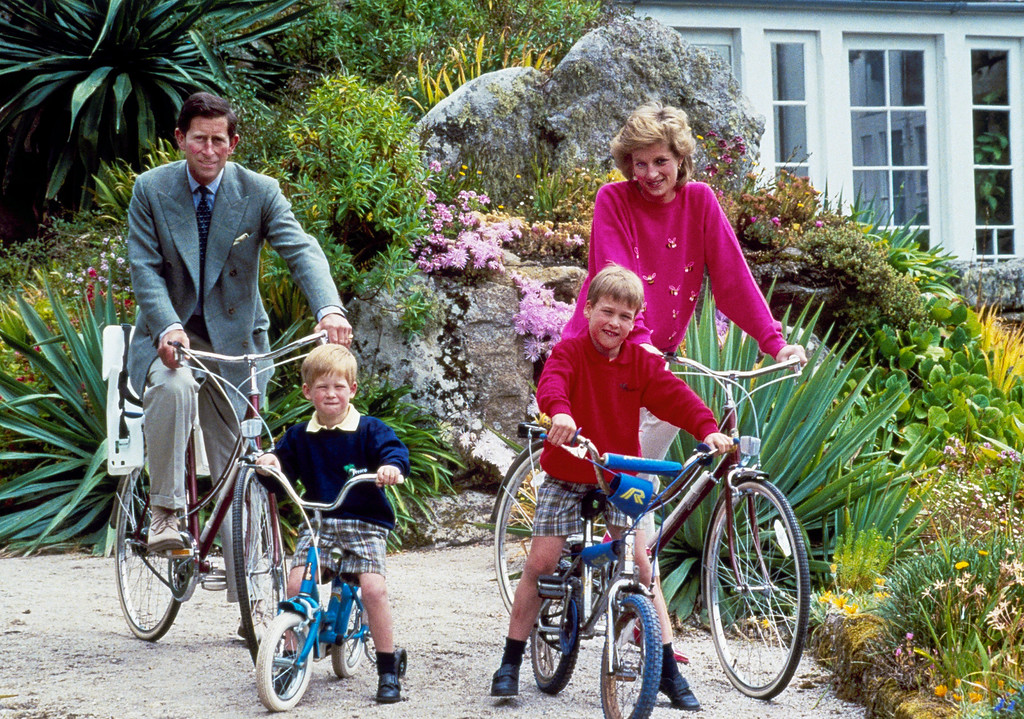 . Britain\'s Prince Charles and Princess Diana and their sons, Princes William, right, and Harry begin a cycle ride, June 1, 1989, around the island of Tresco, one of the Scilly Isles. The royal family was vacationing in the islands, located off the southwest tip of Britain. (AP Photo)