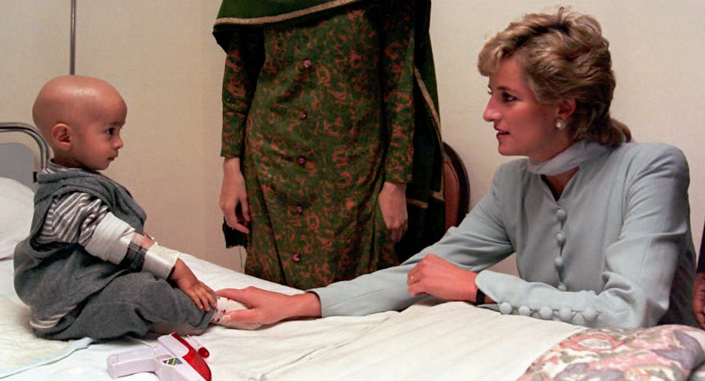 . The Princess of Wales reaches out to touch a young unidentified cancer patient during her visit Thursday February 22 1996 to the cancer hospital founded by former cricket star Imran Khan,  in Lahore, Pakistan.  (AP Photo/Mike Forster, Pool)