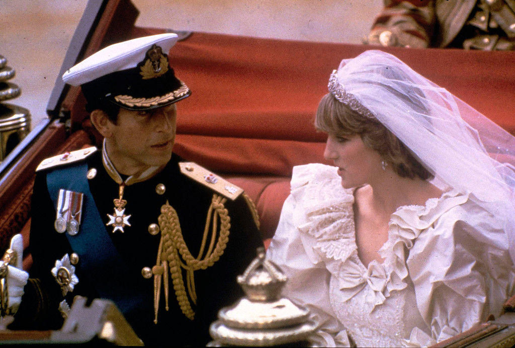 . The carriage carrying the Prince and Princess of Wales passes along Trafalgar Square on its way from St. Paul\'s Cathedral to Buckingham Palace after the royal wedding in London on July 29, 1981. (AP Photo)