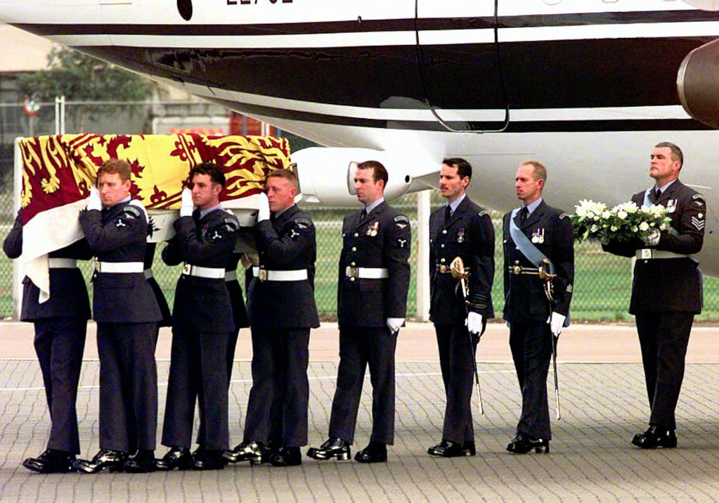 . The coffin containing the body of Diana, Princess of Wales, is carried from an aircraft by airmen of the Royal Air Force, after arriving at Northolt Royal Air Force base from Paris, Sunday Aug. 31, 1997. (AP Photo/Neil Munns)