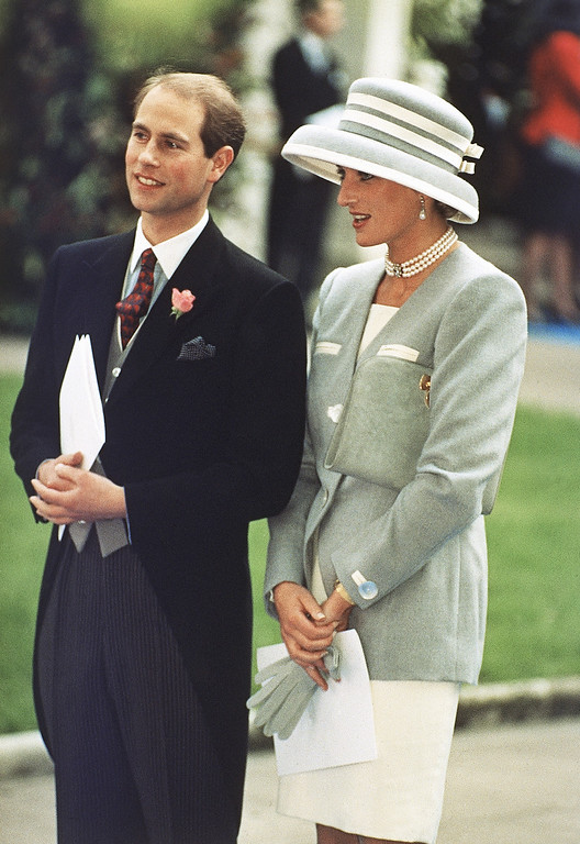. Britain\'s Prince Edward and Princess Diana, the Princess of Wales, watch the departure of Viscount Linley, the nephew of Britain\'s Queen Elizabeth, and Serena Stanhope, daughter of Viscount Petersham, who were married at St. Margaret\'s Church, in London, on Oct. 8, 1993.  (AP Photo/Allen)
