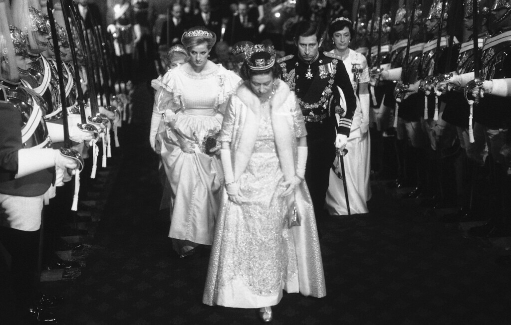 . Britain�s Queen Elizabeth II followed by Princess Diana, the Princess of Wales and Prince Charles, the Prince of Wales, arrive for the State Opening of Parliament in London on Tuesday, Nov. 6, 1984. (AP Photo/Bob Dear/Bipna/Pool/Rota)
