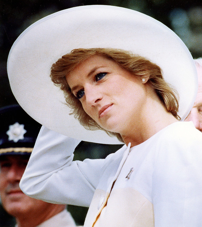 ". Britain\'s Princess Diana, the Princess of Wales, holds on to her hat during a march past by former members of Britain\'s Cavalry Regiments in the annual Combined Cavalry ""Old Comrades\"" Parade, in Hyde Park, in London, on May 14, 1989. The Princess is the Colonel-in-Chief of the 13th/18th Hussars Queen Mary\'s Own, the 270-year-old regiment notable for their engagements at Waterloo and the Charge of the Light Brigade. (AP Photo/Cleaver)"
