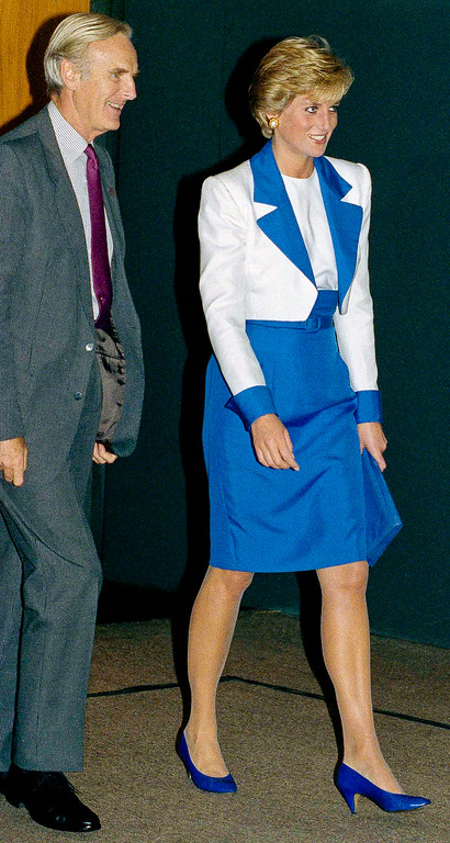 . Her Royal Highness, Princess Diana of Wales is escorted by the British Ambassador to the United States Sir Antony Acland, as she arrived at Dulles Airport in Chantilly, Va. to begin her two-day visit to Washington, Oct. 4, 1990. (AP Photo/Marcy Nighswander)