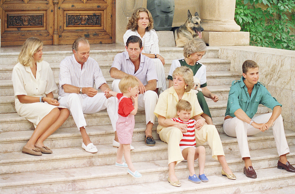 . Prince Harry of England holds hands with host King Juan Carlos of Spain while looking at his mother Diana, Princess of Wales Sunday at the  entrance of Marivent Palace, Palma de Majorca, Spain, where guests of the Spanish Royal Family, spending a week\'s vacation, posed for photographers on Sunday, August 9, 1987.  Top row is Princess Elena; In second row from top is Princess Christina, King Juan Carlos, Prince Charles of England,  and Queen Sophia of Spain. In bottom row is Prince Harry of England; Diana Princess of Wales;  Prince William of England, and Prince Felipe.of Spain.  Princesses Christina and Elena and prince Felipe are Juan Carlos\'s and Queen Sophia\'s children. (AP Photo/Redman)