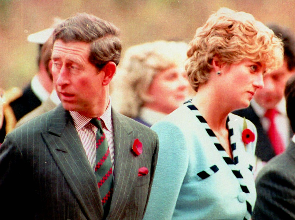 . FILE - Britain\'s Prince and Princess of Wales look their separate ways during a memorial service on their tour of South Korea on Nov.3, 1992.  (AP Photo / FILE)