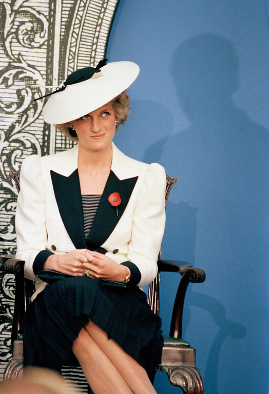 . Diana, the Princes of Wales, casts a glance at her husband Prince Charles as he speaks at a press conference at the National Gallery of Art, in Washington, Nov. 10, 1985. (AP Photo/Bob Daugherty)