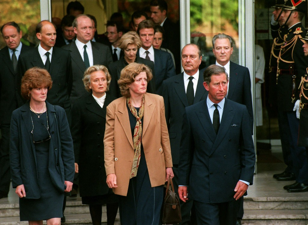 . Prince Charles leaves the Salpetriere Hospital with Princess Diana\'s sisters Lady Jane Fellowes, left, and Lady Sarah McCorquodale, after they came to collect Diana\'s body in Paris Sunday Aug.31, 1997. Diana, her wealthy companion Dodi Fayed and their driver died when their Mercedes Benz crashed at high speed in a tunnel in central Paris while being pursued by paparazzi on motorcycles early Sunday. French President Jacques Chirac and First Lady Bernadette Chirac appear in second row. (AP PHOTO/Laurent Rebours)