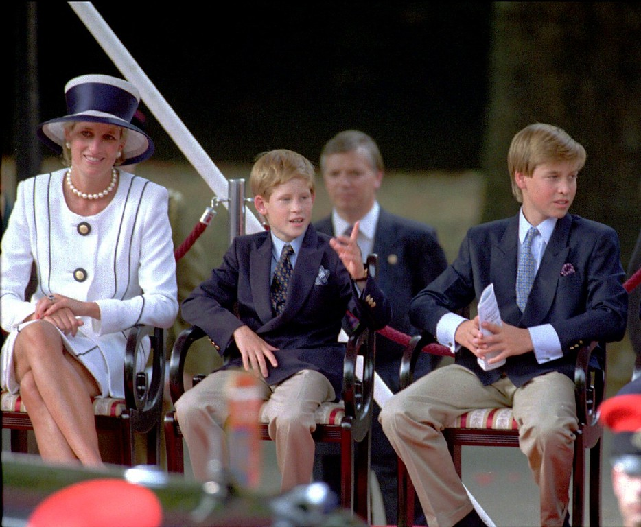 . Princess Diana, left, her sons Prince Harry and Prince William, and Prince Charles watch a veteran\'s parade during the 50th anniversary of VJ Day commemorations in London, Saturday Aug. 19, 1995. V-J Day is being marked in England by memorial services, parades and a spectacular fireworks display over the River Thames. (AP Photo/Alastair Grant)