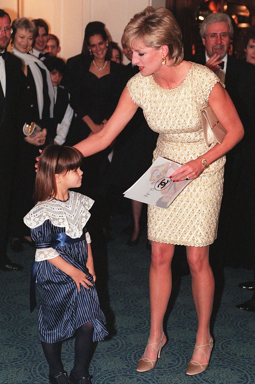 . Britain\'s Princess of Wales thanks Greta Born, aged 4, after she had received a programme prior to a Royal Gala Preformance of Alice in Wonderland, by The English National Ballet at the Coliseum in London, Tuesday Mar. 19, 1996. (AP Photo/Louisa Buller)