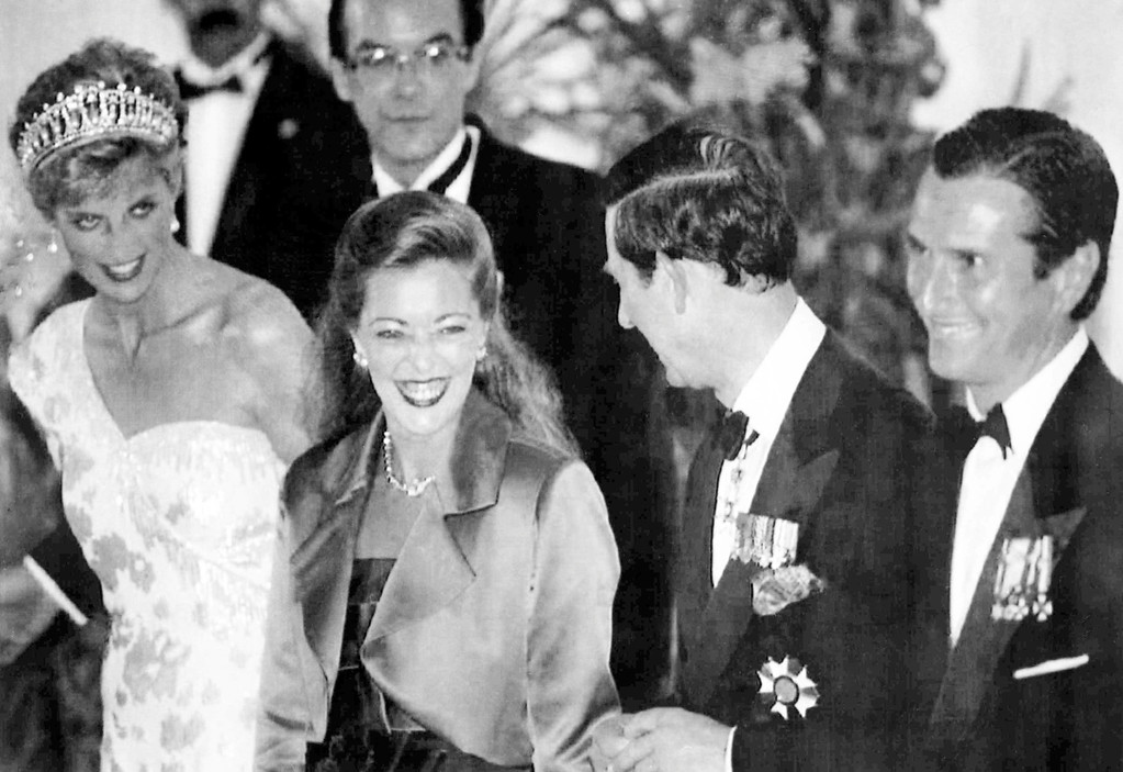 . Britain\'s Prince Charles, second right, and Princess Diana, left, chat together whilst posing with President Fernando Collor, right, and his wife Rosana Collor before a banquet in Brasilia, on April 24, 1991, to mark the Royal couple\'s state visit to Brazil. (AP Photo/Caulkin)