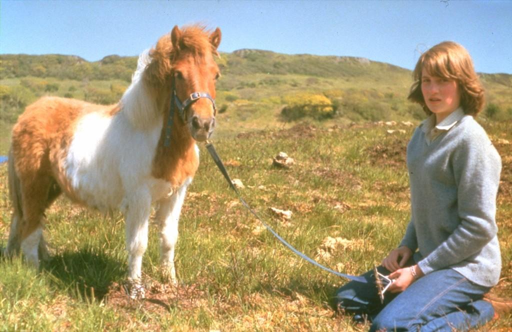 . YOUNG GIRL, ROYALTY, SHETLAND PONY, GRASS, HILLS, POSING, ANIMAL.