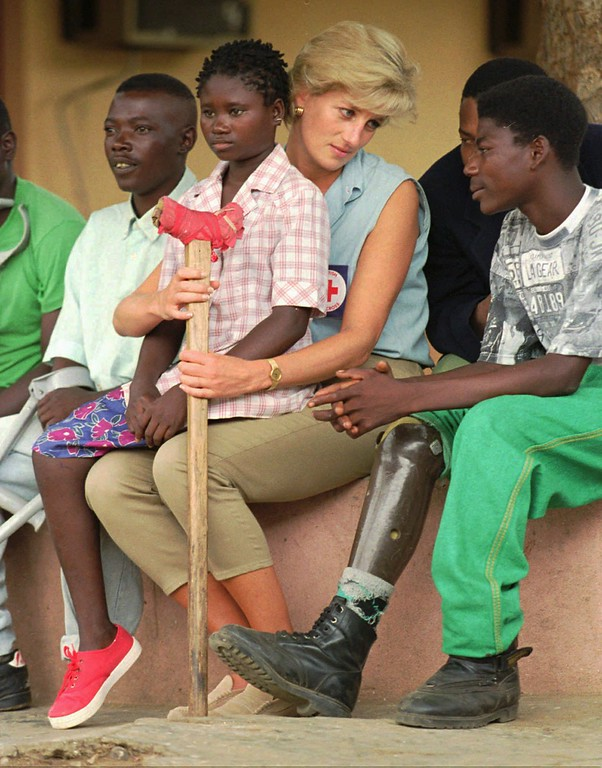 . FILE--Britain\'s Princess Diana talks to amputees in this Jan. 14, 1997 file photo, at the the Neves Bendinha Orthopedic Workshop on the outskirts of Luanda, Angola. Sitting on Diana\'s lap is 13-year-old Sandra Thijica, who lost her left leg to a land mine while working the land with her mother in Saurimo, eastern Angola, in 1994. Diana, 36, died after a car accident Sunday, Aug. 31, 1997, in Paris. (AP Photo/Joao Silva, File)