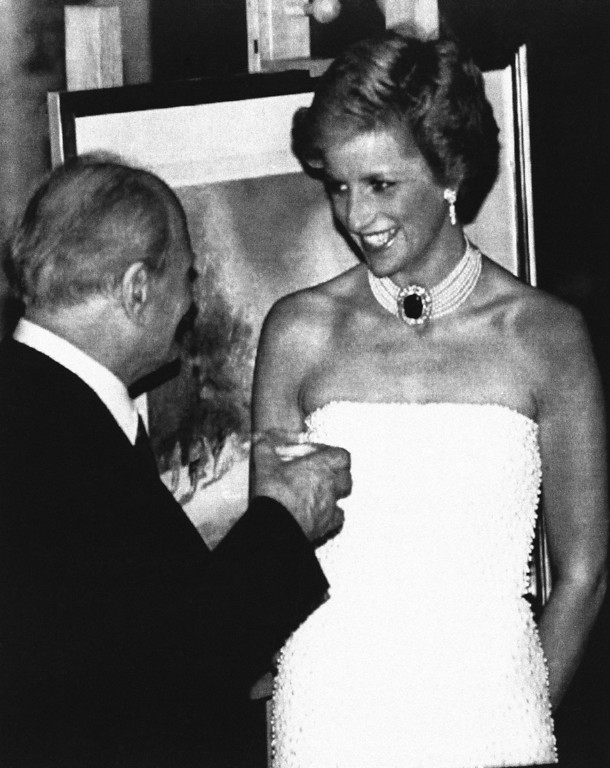 . A sparkling Princess of Wales chats to President Arpad Goncz, new President of Hungary on Monday, May 7, 1990, before attending a dinner hosted by the President in honour of the Prince and Princess of Wales who began their four day tour of Hungary in afternoon on Monday. (AP Photo/Martin Keene)