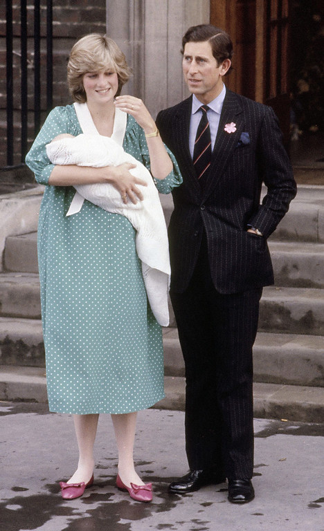 . Britain\'s Prince Charles, Prince of Wales, with his wife Princess Diana, holding her newborn son Prince William, as they leave St. Mary\'s Hospital, Paddington, London, June 22, 1982. (AP Photo/Staff/Redman)
