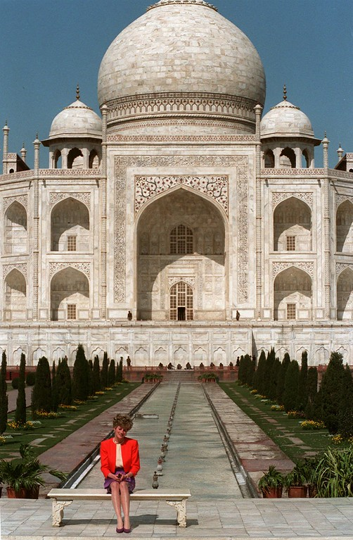 . Princess Diana sits in front of the Taj Mahal in the Indian city of Agra, Tuesday Feb. 11, 1992. (AP Photo/Udo Weitz)
