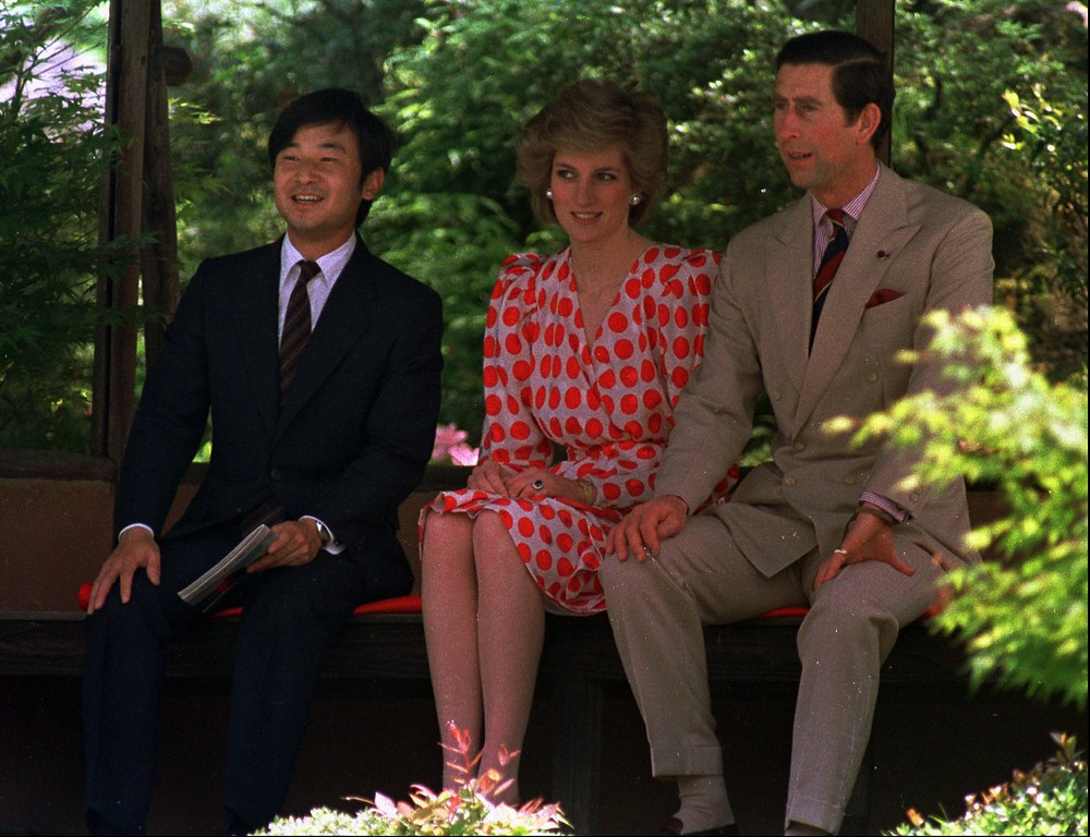 . FILE -- Prince and Princess of Wales and Japanese Prince Naruhito, left, take a rest from a stroll in the garden of the 17th century Shugakukin Imperial Villa they visited in Kyoto, western Japan, in this 1986 file photo. (AP Photo/Sadayuki Mikami)