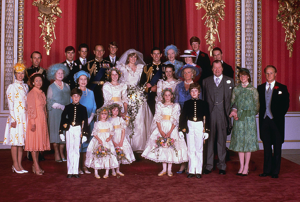 . Prince Charles and his new bride Diana, Princess of Wales, pose for a family portrait with other members of the royal family, in the Throne Room of Buckingham Palace, on their wedding day July 29, 1981. (AP Photo)