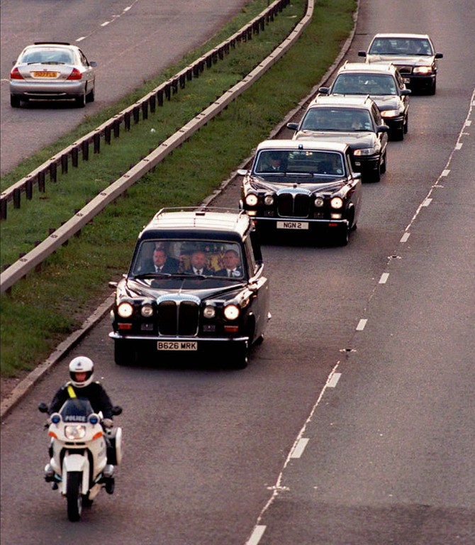 . Diana, Princes of Wales\' body is escorted by an entourage into London from RAF Northholt Sunday evening Aug 31 1997 where the had body arrived by plane from Paris.  Diana, Princess of Wales was killed in a car crash in Paris early Sunday morning. Dodi Fayed, her companion and the driver also died in the crash. (AP Photo/ Mike Stephens)