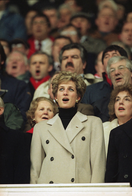 . The Princess of Wales surrounded by fellow spectators sings the Welsh national anthem prior to the start of the Wales v France rugby match at Cardiff Arms Park in Cardiff, Wales on Saturday, Feb. 19, 1994.  (AP Photo/Martin Cleaver)
