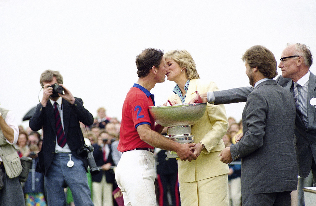 . The Prince of Wales gets a kiss from his wife Diana, Princess of Wales, as well as the Silver Jubilee Cup, after the Prince of Wales� Team had defeated Peru by seven goals to five at the International Polo meeting at the Guards Polo Ground in Great Windsor Park, England on Sunday, July 26, 1987. (AP Photo)