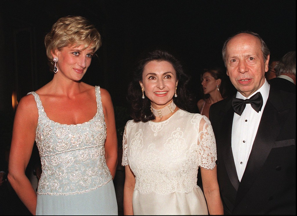 . The Princess of Wales, left, poses with Donatella Dini and her husband Lamberto Dini, Italian Foreign Minister, at the French Embassy during fund-raiser for cancer research fashion show by Krizia in Rome Wednesday June 19 1996. (AP Photo/Enrico Oliverio, Pool)