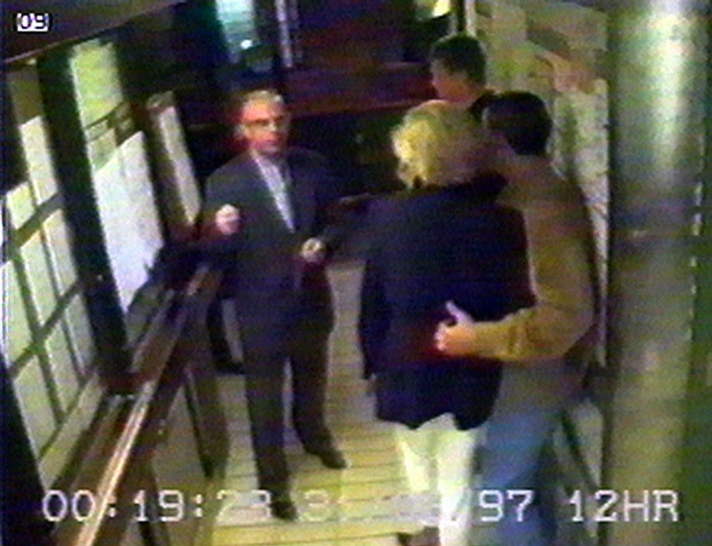 . Dodi Fayed, right, puts his arm around Britain\'s Diana, Princess of Wales, center with back to camera, in this picture made from a security video taken at the Ritz Hotel in Paris, in the early hours of Sunday morning, Aug. 31, 1997, as they talk to Henri Paul, left. Bodyguard Trevor Rees-Jones, the sole survivor of the crash, is seen in the background. Not long after, the car driven by Paul crashed killing him, Dodi Fayed and seriously injuring Princess Diana and a her bodguard. The princess died laterin a Paris hospital of her injures. (AP Photo/APTV)