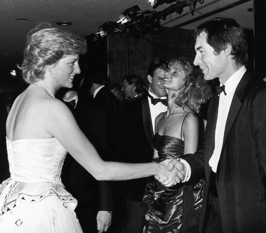 ". File - In this Monday, June 29, 1987 file photo, Princess Diana meets Timothy Dalton, who succeeded Roger Moore as James Bond at the charity premiere of ""The Living Daylights\"" at London\'s Odeon Cinema.  (AP Photo/Pool, File)"