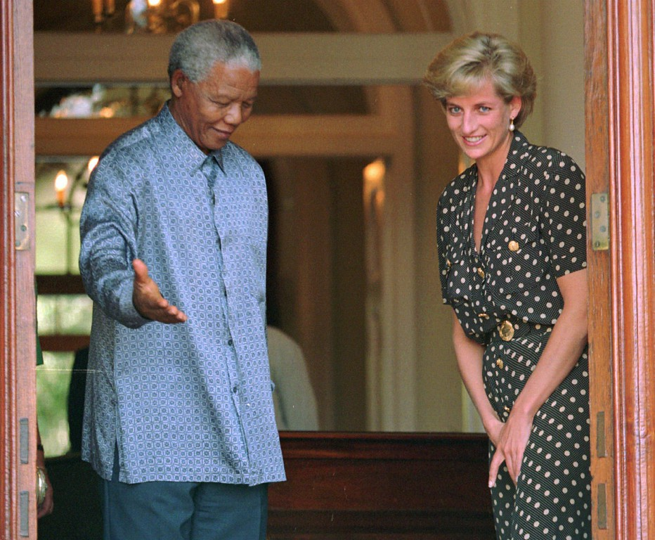 . South African President Nelson Mandela, left, shows the way to Princess Diana,  during in Cape Town, Monday, March 17 1997. Diana met Mandela to discuss the threat of AIDS in South Africa. (AP Photo/Sasa Kralj)