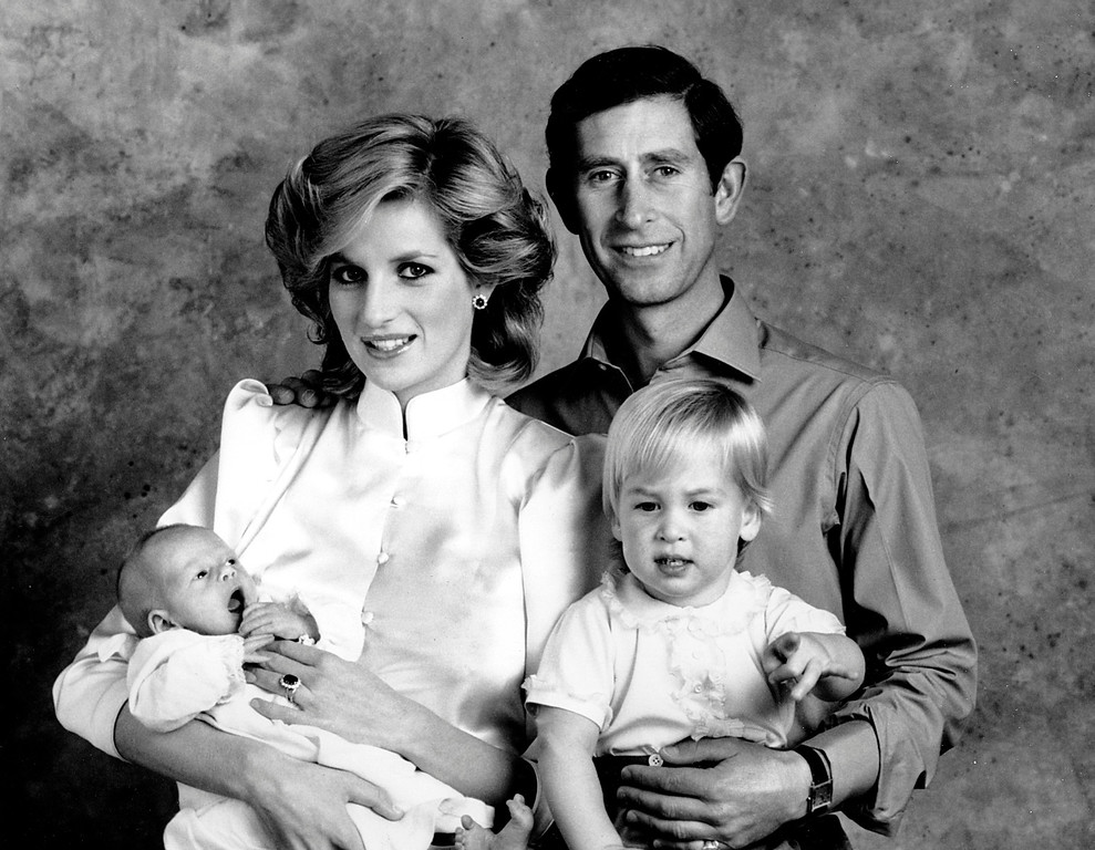 . The Prince and Princess of Wales, Prince Charles and Princess Diana, pose for a family portrait with their sons, Prince William, right, and Prince Harry, at the Kensington Palace in London, England on Oct. 6, 1984.  (AP Photo)