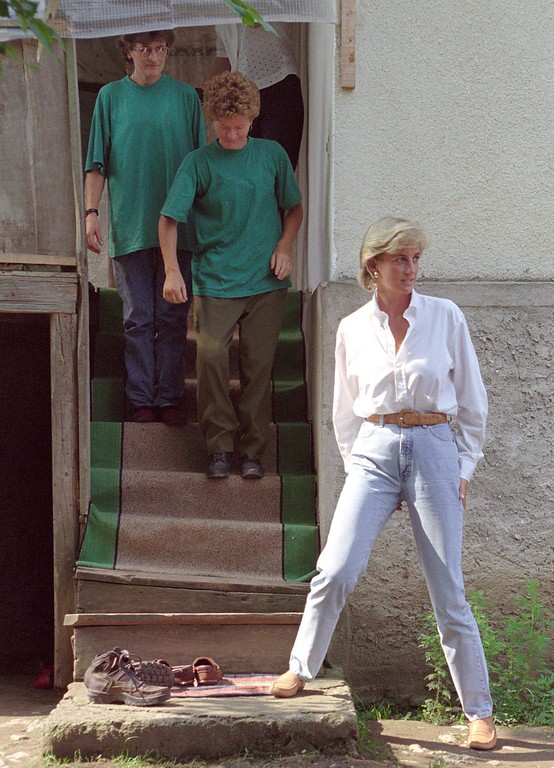 . File Photo: from 9 August 1997. Lady Diana, Princess of Wales walks down wooden stairs as she exiting house of Mirsada and Fahrija Djulic, in the village of Sockovac.  (AP Photo/Amel Emric)