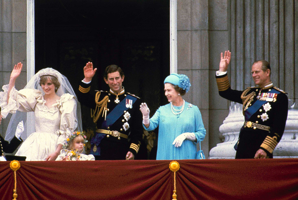 . Prince Charles and his bride Diana, Princess of Wales, wave from the balcony of Buckingham Palace after their marriage July 29, 1981, at St. Paul\'s Catheral.  (AP Photo)