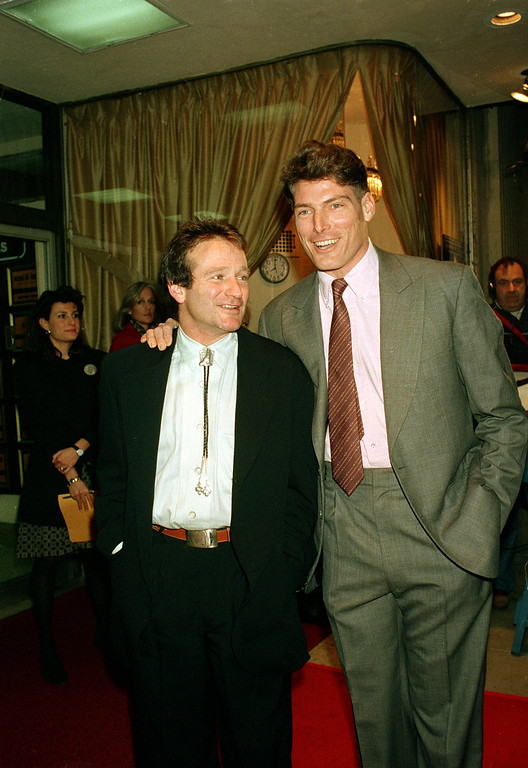 """. Actor Christopher Reeve, right, poses with colleague Robin Williams as he attends the premiere of Williams\' new motion picture \""""Good Morning, Vietnam,\"""" in New York, December 1987.  (AP Photo/Ed Bailey)"""
