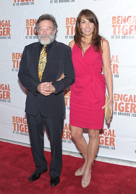 """. Actor/comedian Robin Williams and Susan Schneider attend the after party for opening night of \""""Bengal Tiger At The Baghdad Zoo\"""" at Espace on March 31, 2011 in New York City.  (Photo by Michael Loccisano/Getty Images)"""