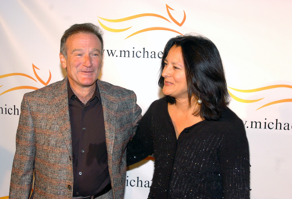 ". Comedian Robin Williams and wife Marsha arrive at ""A Funny Thing Happened on the Way to Cure Parkinson\'s...\"" a benefit evening for the Michael J. Fox Foundation for Parkinson\'s Research Saturday, Nov. 13, 2004 at the Waldorf Astoria in New York. (AP Photo/Gina Gayle)"
