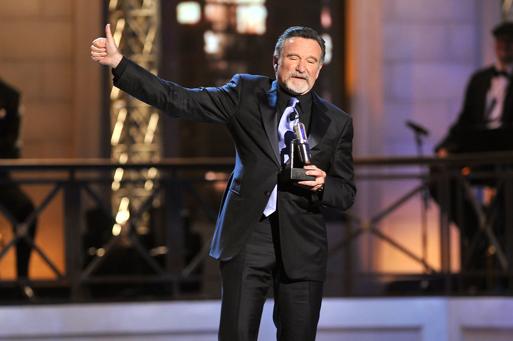. Comedian Robin Williams accepts an award onstage at The Comedy Awards 2012 at Hammerstein Ballroom on April 28, 2012 in New York City.  (Photo by Theo Wargo/Getty Images)