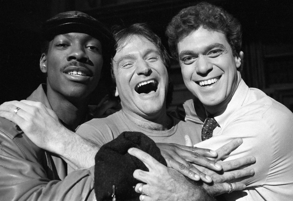 . Robin Williams, center, takes time out from rehearsal at NBC\'s Saturday Night Live with cast members Eddie Murphy, left, and Joe Piscopo, Feb. 10, 1984.   (AP Photo/Suzanne Vlamis)