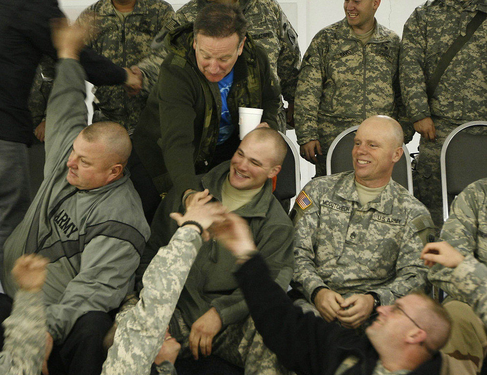 . U.S. comedian Robin Williams, center row at left, greets U.S soldiers at a U.S base in Kabul, Afghanistan, Thursday, Dec. 20, 2007. (AP Photo/Rafiq Maqbool)