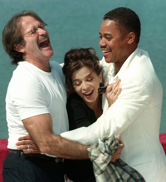""". File - US actors Robin Williams, left, and Cuba Gooding Jr. share a laugh with American actress Annbella Sciorra after a press conference in Cannes Thursday may 15, 1997, announcing they will star in \"""" What dreams may come\"""", a love story directed by Vincent Ward. The film starts shooting in June in Monatana and San Francisco. (AP photo/Remy de la Mauviniere)"""