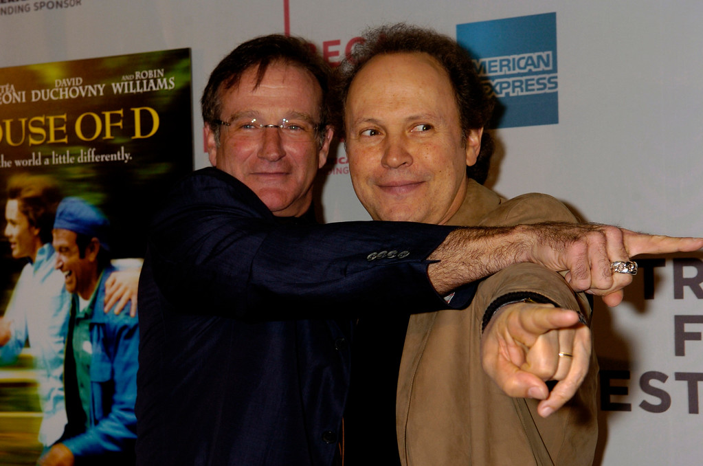 """. Actor Robin Williams, left, and actor Billy Crystal arrive for the world premiere of the movie \"""" House of D\"""" in which Robin stars at the 3rd Annual Tribeca Film Festival, Friday, May 7, 2004, in New York. (AP Photo/Louis Lanzano)"""