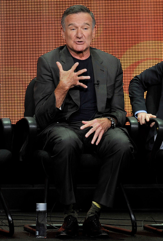 ". Robin Williams participates in ""The Crazy Ones\"" panel at the CBS Summer TCA on Monday, July 29, 2013, at the Beverly Hilton hotel in Beverly Hills, Calif. (Photo by Chris Pizzello/Invision/AP)"