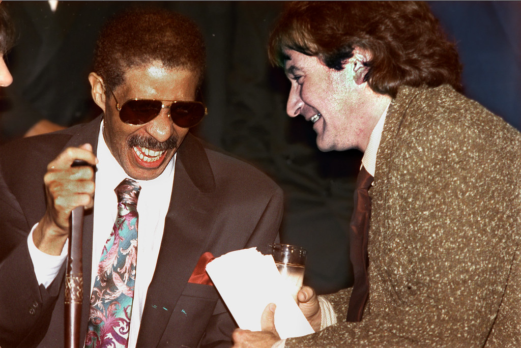 . Comedians Richard Pryor, left, and Robin Williams share a laugh at the New York Friar\'s club in a  Friday Sept. 27, 1991 photo. (AP Photo/Andrew Savulich, file)