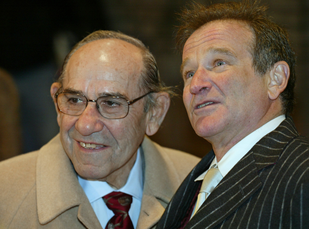 . Actor and comedian Robin Williams, right, joins baseball legend Yogi Berra outside the Broadhurst Theater in Times Square for the opening of Billy Crystal\'s new show titled 700 Sundays, New York, Sunday, Dec. 5, 2004.   (AP Photo/Stuart Ramson)